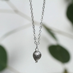 Sterling Silver Tiny Heart Cardamom Pod Necklace from Thicket